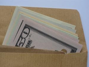 1384588_brown_envelope_money_bribe_1.jpg